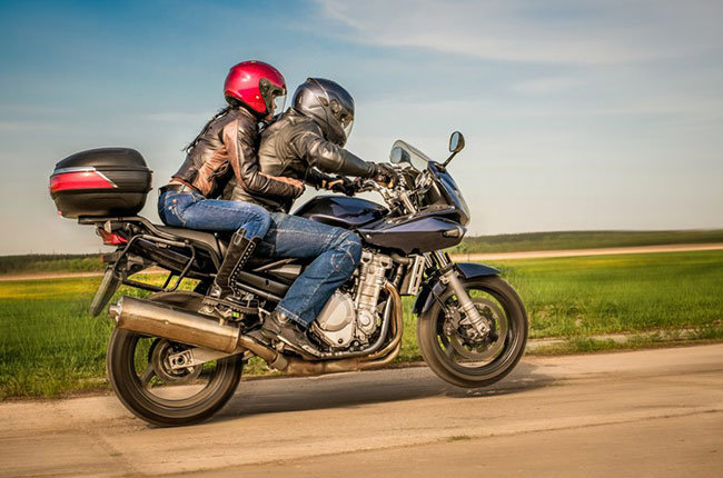 Couple riding a motorcycle 2