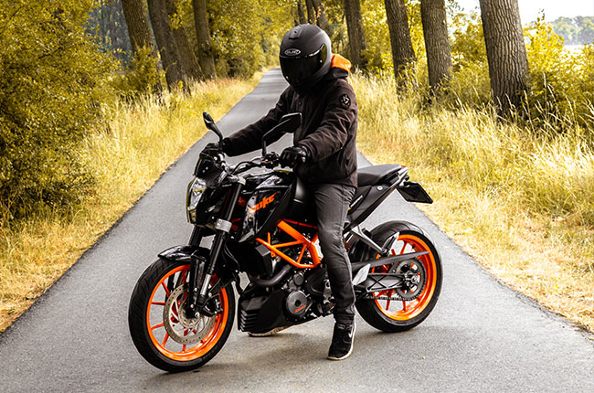 Motorcycle rider in full safety gear