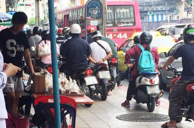 Motorcycles On Sidewalk