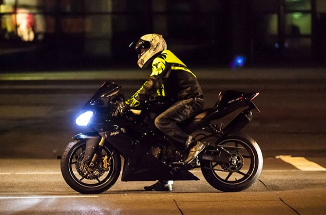 Motorcyclist wearing high-visibility jacket