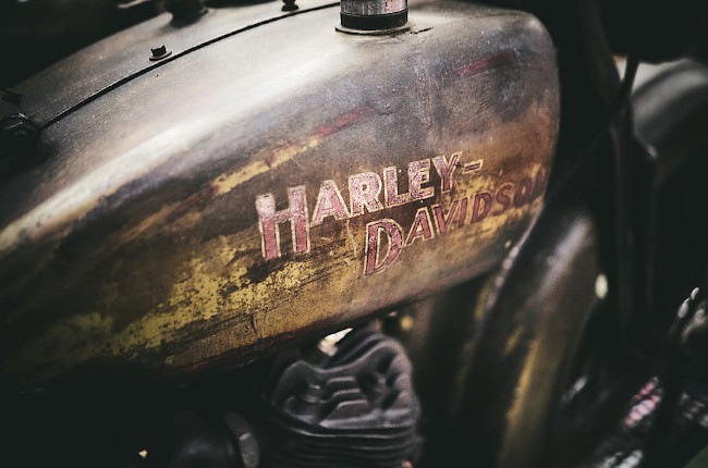 What should I do if my motorcycle's fuel tank begins to rust?