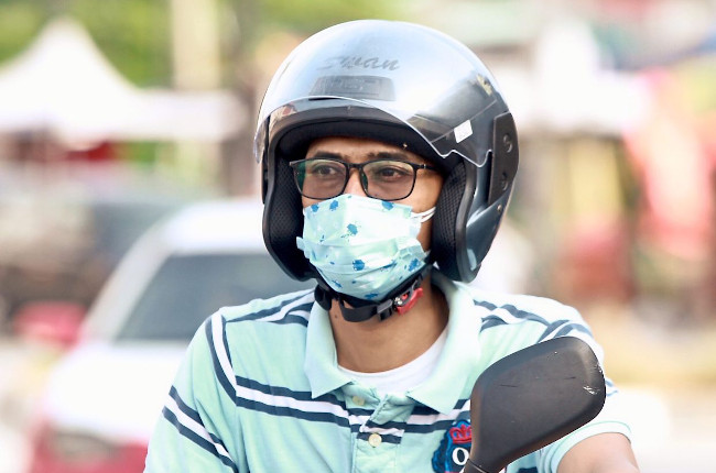 Facemask required while riding motorcycles.