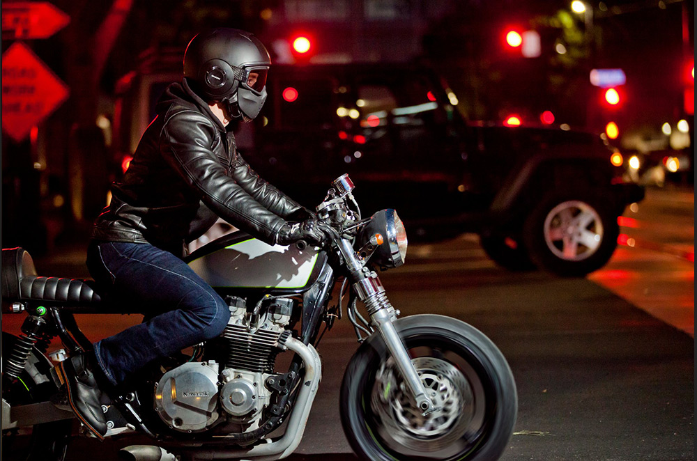 Motorcyclist riding at nighttime