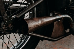 How do I clean a modern motorcycle exhaust