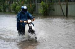 Motorcycle crossing flooded street