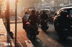 Motorcycle riders in traffic