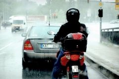 What is hydroplaning and how do I avoid it on a motorcycle?